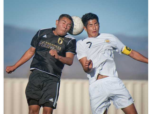 Valencia's Gerardo Gonzalez head butts the ball against Golden Valley's Billy Torres Argueta during Friday's game at Golden Valley High School.