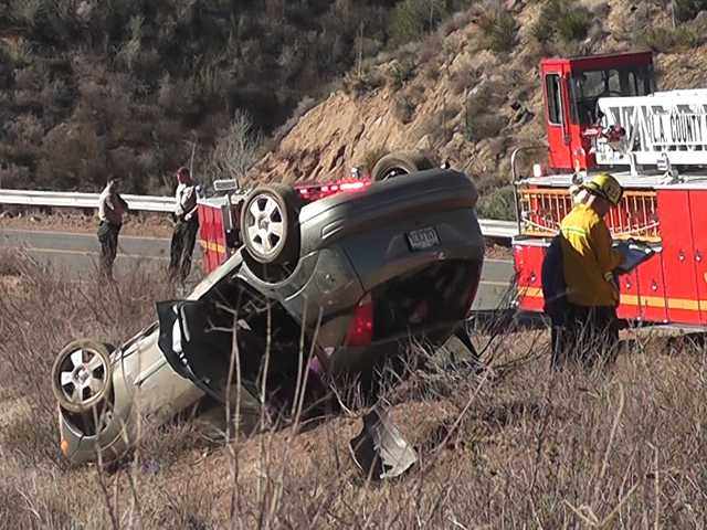 Three people were transported to the hospital this morning following a rollover crash. Photo courtesy of Louie Gallardo/Video Specialties.