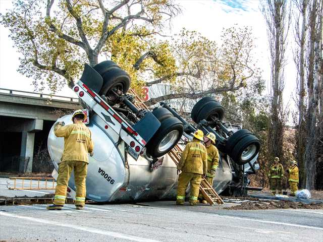 Crews examine the overturned trailer of the tanker that crashed Sunday morning on Rye Canyon Road in Valencia, spilling an estimated 50 gallons of crude oil onto the road. Photo courtesy of Stanley Elrich.