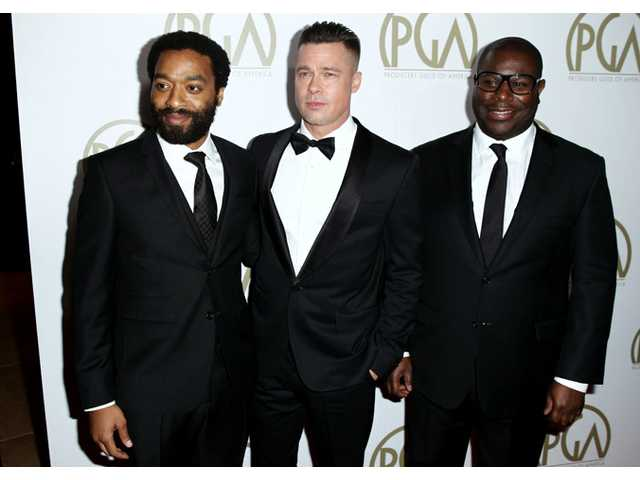 Steve McQueen, right, Chiwetel Ejiofor, left, and Brad Pitt arrive at the 25th annual Producers Guild of America Awards at the Beverly Hilton Hotel in Beverly Hills on Sunday.