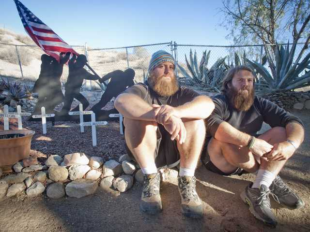Anthony Anderson, left, and Tom Voss sit for a portrait at a VFW post in Canyon Country on Monday. Anderson and Voss are taking a break from a 2,700 mile trek on foot from Milwaukee to Santa Monica Pier to raise awareness about veteran's issues. Signal photo by Charlie Kaijo.