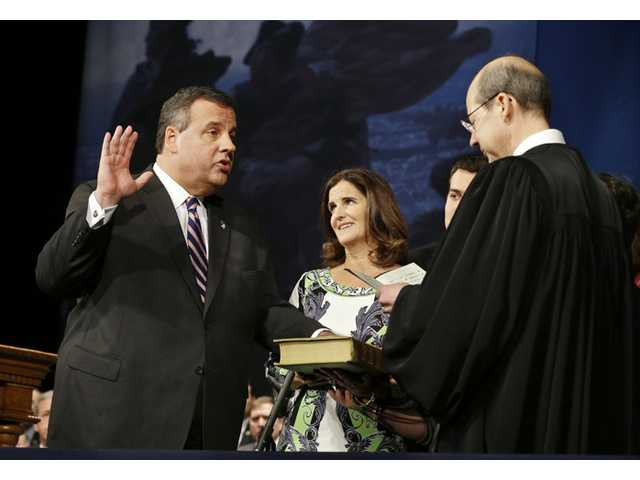As wife Mary Pat Christie holds the Bible, New Jersey Gov. Chris Christie is sworn in for his second term by New Jersey Supreme Court Chief Justice Stuart Rabner, right, Tuesday in Trenton, N.J.