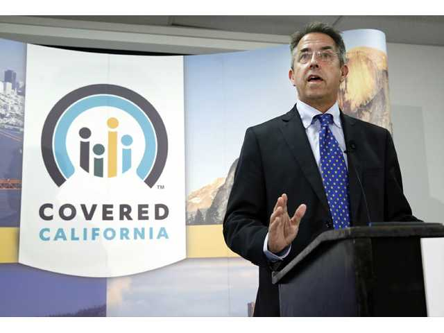 In this Nov. 13, 2013 file photo, Peter Lee, executive director of Covered California, announces that sign-ups have accelerated in November for health insurance during the first month of open enrollment in Sacramento.
