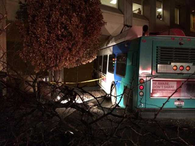 In this photo provided by the Boise Fire Department via the Boise Police Department, a city passenger bus is shown that has crashed into the Idaho Power corporate headquarters building early Monday.
