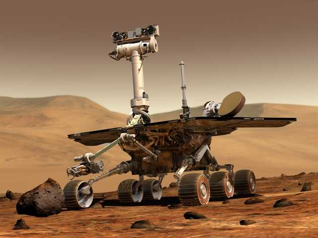 This artist rendering released by NASA shows the NASA rover Opportunity on the surface of Mars. Opportunity landed on the red planet in 2004 and is still exploring.