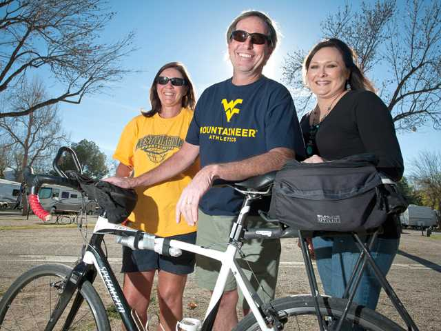 From left, Pam Rose, Mike Rose and his cousin Marina Jarocki stand for a portrait at the Valencia Travel Village. Rose took a bike trip from his Pennsylvania home across the U.S. to see Jarocki, who lives in Valencia. Signal photo by Charlie Kaijo.