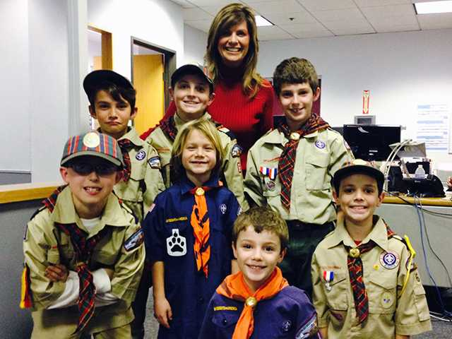 Cub Scout Pack 66 from Helmers Elementary School in Valencia toured The Signal newsroom Jan. 21 while working on earning their Communicator Activity Badge. Alesia Humphries /courtesy photo