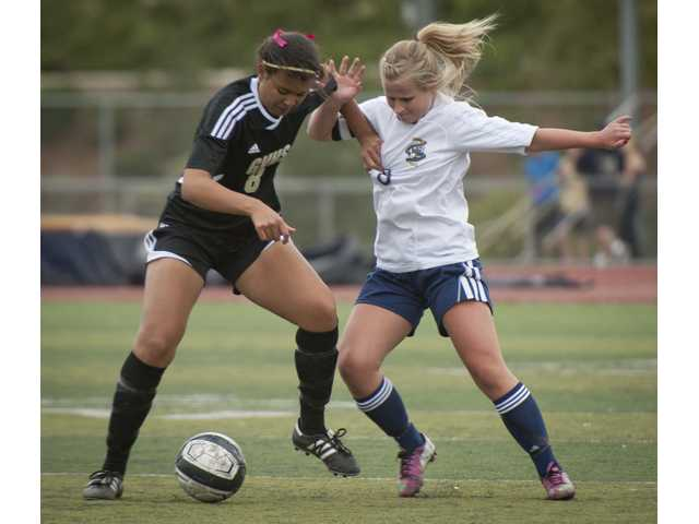 West Ranch's Noelle Weber fights for the ball against Golden Valley's Courtney Ravenell during Friday's game at West Ranch High School.