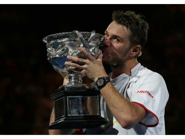 Stanislas Wawrinka kisses the trophy after winning the Australian Open men's singles title on Sunday in Melbourne, Australia.