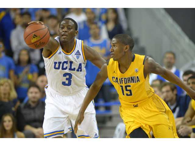 UCLA guard Jordan Adams, left, grabs a loose ball away from Cal guard Jordan Mathews on Sunday in Los Angeles.