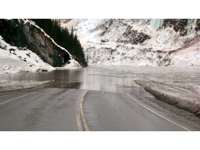 This Jan. 24 photo provided by the Alaska Department of Transportation & Public Facilities shows multiple avalanches that crossed the Richardson Highway in the Thompson Pass region of Valdez, Alaska, causing flooding.
