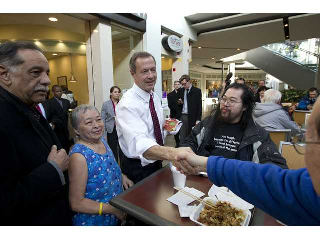Maryland Gov. Martin O'Malley shakes hands with customers at the Mall in Columbia, Md, after the mall was reopened to the public on Monday. Three people died Saturday in a shooting at a mall in suburban Baltimore, including the presumed gunman.