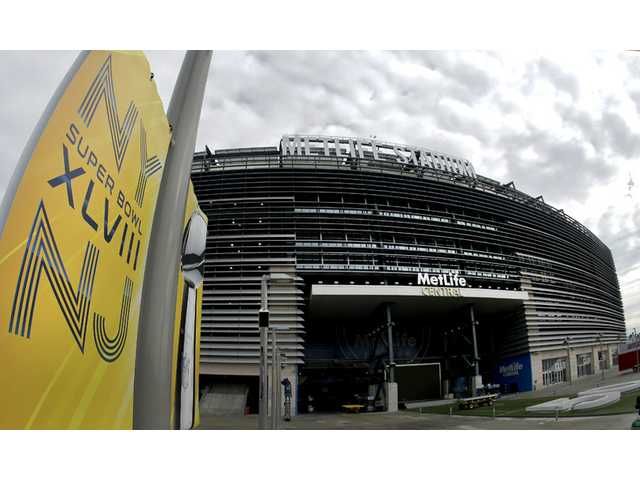 A banner is seen outside MetLife Stadium on Monday in East Rutherford, N.J. The stadium will host Sunday's NFL Super Bowl XLVIII football game between the Denver Broncos and the Seattle Seahawks.