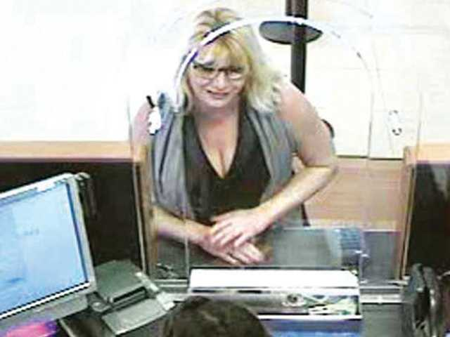 "This surveillance photo provided by the Sheriff's Department shows a woman identified as the ""blond scammer."""