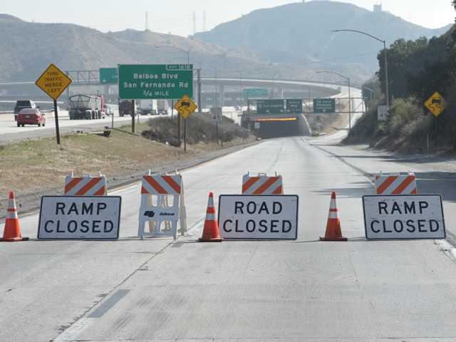 Barricades block the truck transition lanes from the South bound Interstate 5 Freeway to the Antelope Valley Freeway due a gravel spill further south on the 5 freeway snarling traffic on Tuesday morning. Signal photo by Dan Watson.
