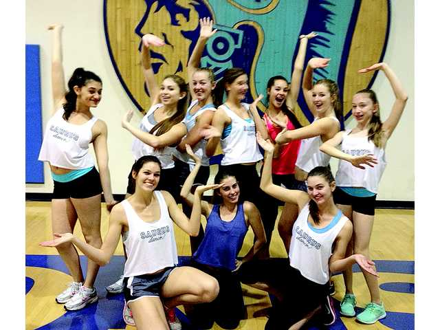 Members of the Saugus High School Dance Team take time during a break from a 90-minute Zumba Fitness fundraiser Sunday to pose under the school's centurion symbol. Signal photo by Jim Holt.