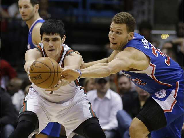 Los Angeles Clipper Blake Griffin (32) steals the ball from Milwaukee's Ersan Ilyasova, left, during Monday's game in Milwaukee.