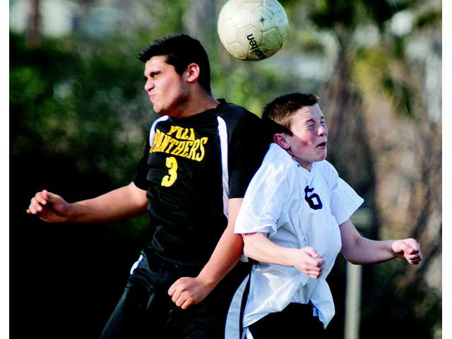 SCCS's Billy Latch, right, heads the ball against Yeshiva's Josh Manesh, left, at Canyon Country Park on Monday.