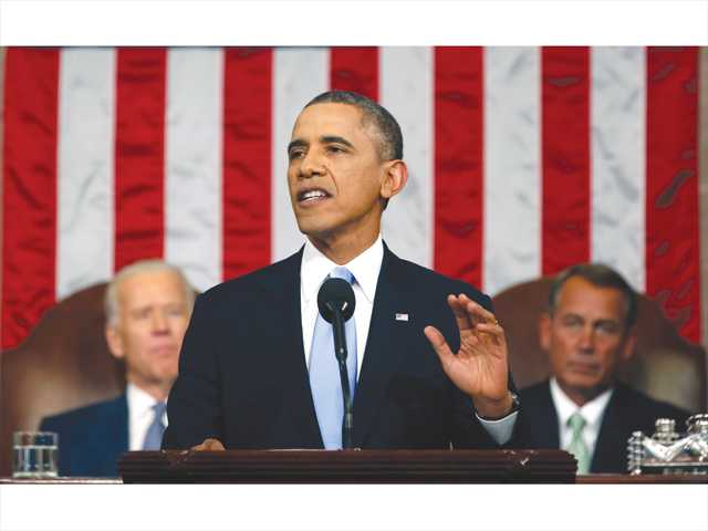 President Barack Obama delivers the State of Union address before a joint session of Congress in the House chamber Tuesday in Washington, as Vice President Joe Biden, left, and House Speaker John Boehner of Ohio, listen.