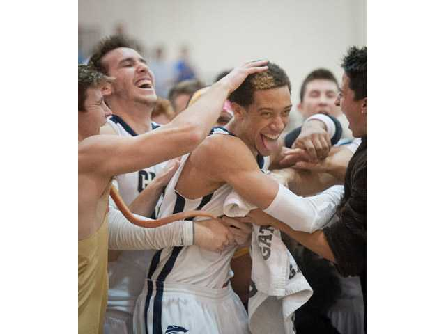 West Ranch's Chrisitian Ware-Berry, center, celebrates after the game with West Ranch High School students and teammates on Tuesday.
