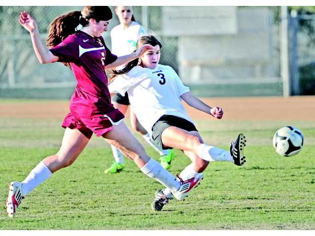 Santa Clarita Christian School's Lauren Gallagher (3) takes a shot in the second half against an AGBU defender at Canyon Country Park on Wednesday.