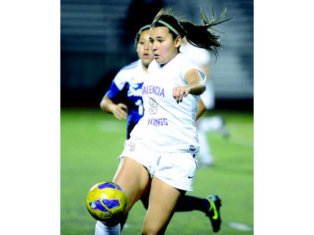 Valencia's Carolina Velez settles the ball in front of her. Valencia leads the league with a 4-0-1 record.