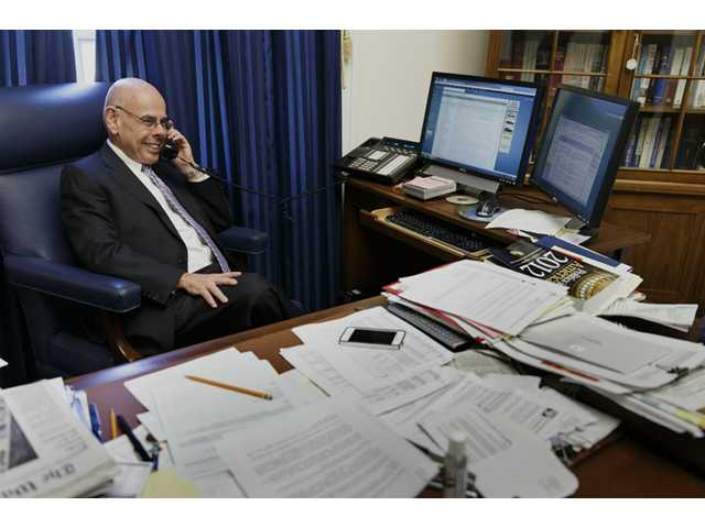 Rep. Henry Waxman, D-Calif. fields a flurry of phone calls in his Capitol Hill office in Washington on Thursday.