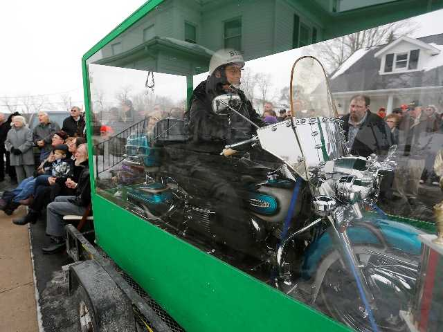 The body of Bill Standley secured to his 1967 Harley Davidson rests inside a plexiglass box during his funeral service on Friday.