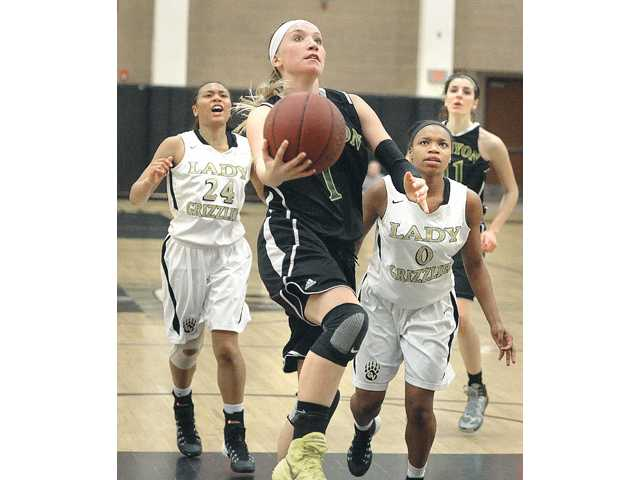 Canyon's Kali Vittallo (1) scores against Golden Valley defenders Azaria Hill (24) and LaDaesha Merriweather (0) at Golden Valley on Friday.