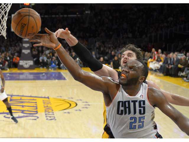 Charlotte Bobcats center Al Jefferson, right front, puts up a shot against Los Angeles Lakers center Pau Gasol on Friday in Los Angeles.