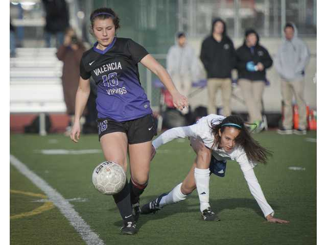 Valencia's Samantha Simon dribbles the ball past Saugus' Therese Blackstock on Friday at Saugus High School on Friday.