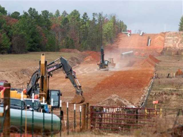 In this Dec. 3, 2012 file photo, crews work on construction of the TransCanada Keystone XL Pipeline near County Road 363 and County Road 357, east of Winona, Texas.