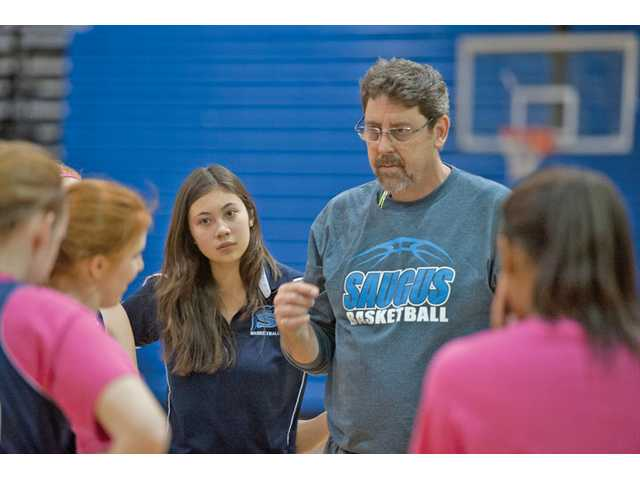 Saugus High assistant coach Kayleigh Lau, left, joined the staff this season after playing last year under head coach Kent Eaton, right.