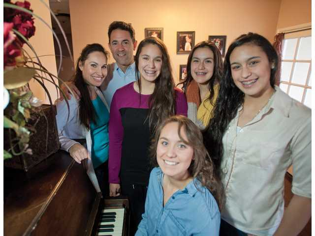 The Cespedes family, from left, Vicki, Jan, Giana, Ivana, Briana and Belicia, stands for a portrait at their home in Canyon Country.