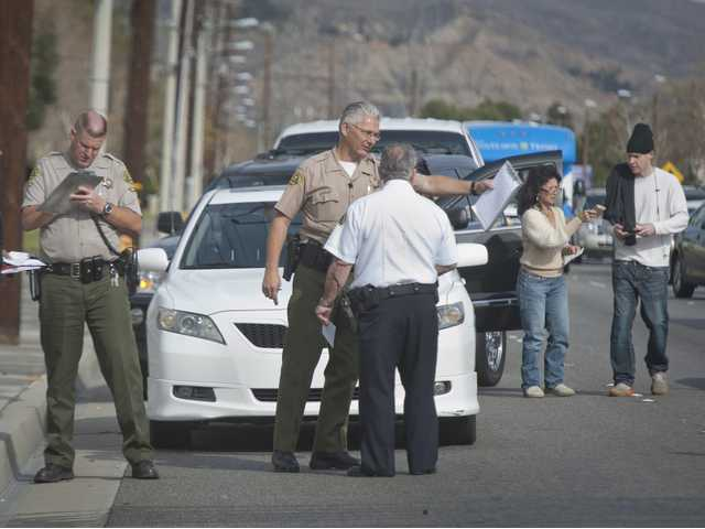 Sheriff's deputies take statements from drivers following multiple collisions on Soledad Canyon Road in Canyon Country on Tuesday. Signal photo by Charlie Kaijo