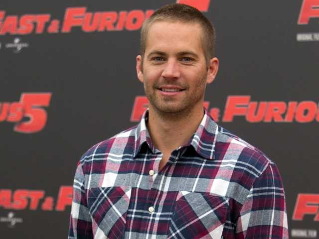 "Paul Walker posing in 2011 for the movie ""Fast and Furious 5."" Court records filed in Santa Barbara on Tuesday show that Walker's estate is worth an estimated $25 million."