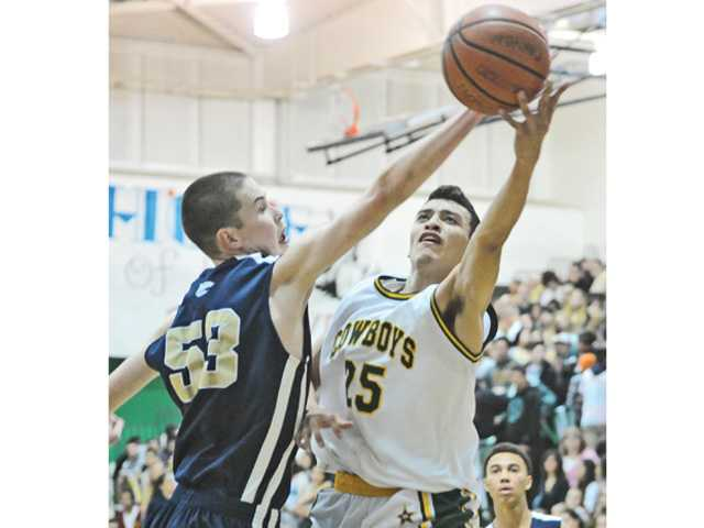 West Ranch's Ryne Williams (53) blocks a shot by Marc Cabrera (25) of Canyon High at Canyon on Tuesday.