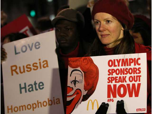 Lesbian and Gay Rights activists take part in a demonstration aimed to coincide with the upcoming Winter Olympics in Sochi, Russia, against laws aimed at stifling Gay Rights in Russia, opposite Downing Street in London on Wednesday.