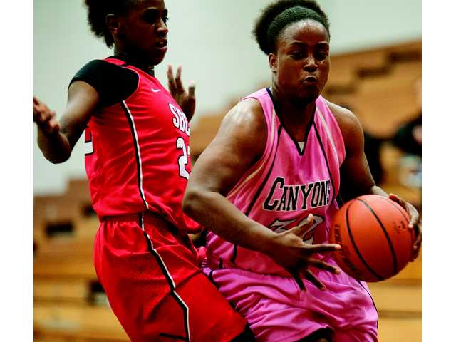 College of the Canyons' KeKe Mathews pushes past a Santa Barbara City College defender on Wendesday's at COC.
