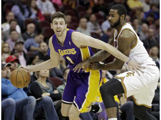 Lakers rookie Ryan Kelly (pictured left) scored a career-high 26 points on Wednesday for the Lakers in Cleveland.