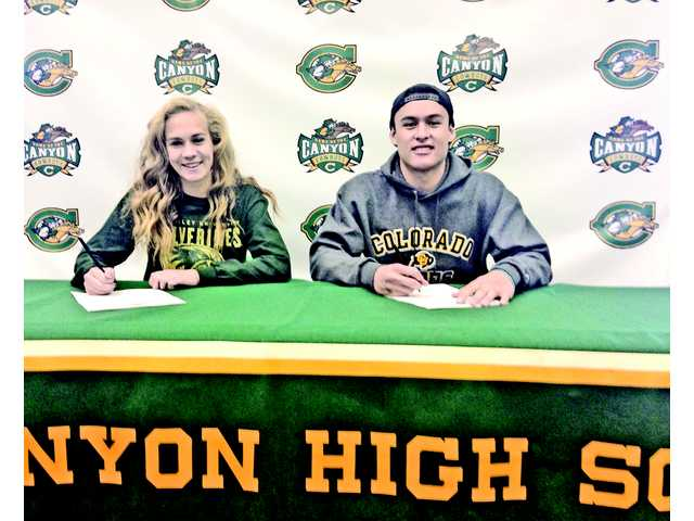 The Canyon High students to sign were, from left to right, Sarah Cipperley (soccer, Utah Valley University) and Cade Apsay (football, Colorado).