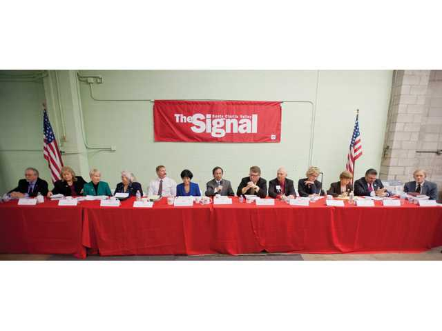 The thirteen candidates running for City Council meet for a forum at The Signal offices in Valencia on Thursday. (From left to right) Alan Ferdman, Sandra Bull, Laurene Weste, Berta Gonzalez-Harper, Paul Wieczorek, Gloria Mercado-Fortine, Moazzem Chowdhury, Stephen Daniels, Duane Harte, Maria Gutzeit, Marsha McLean, Dante Acosta and Dennis Conn. Signal photo by Charlie Kaijo.