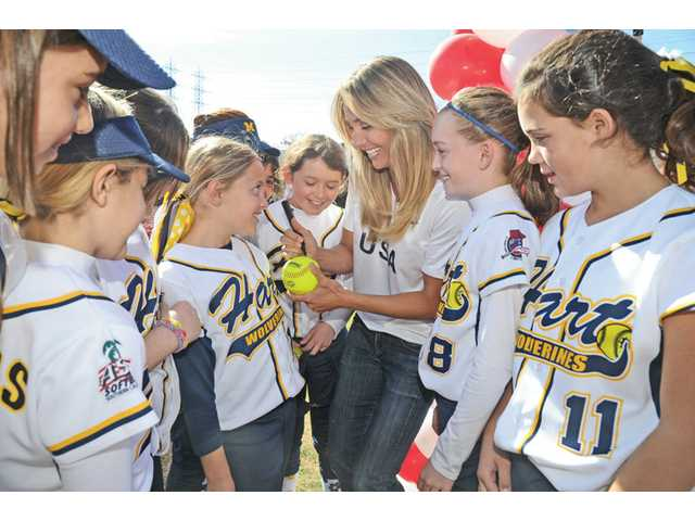Olympic Gold medalist in softball Nicole Guordano, center, signs autographs for 9- and 10-year-olds of the William S. Hart Pony League girls softball at the League's 60th anniversary event held at the league's sports complex.