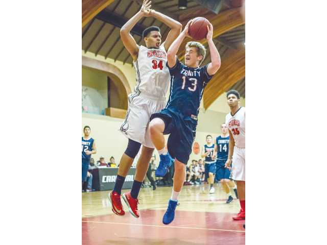 Trinity Classical Academy's Ian Caddow, right, takes a shot against Santa Clarita Christian's Phillip Webb on Friday at SCCS. Photo courtesy of Wally Caddow.