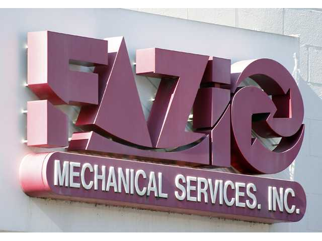 "A sign for Fazio Mechanical Services Inc. is at their location in Sharpsburg, Pa. on Friday. The western Pennsylvania heating and refrigeration contractor issued the statement late Thursday, saying it was the victim of a ""sophisticated cyberattack operation."""