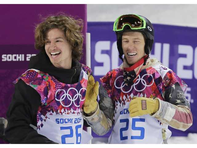 Switzerland's Iouri Podladtchikov, left, celebrates with Shaun White of the United States after Podladtchikov won the gold medal in the men's snowboard halfpipe final at the Rosa Khutor Extreme Park, at the 2014 Winter Olympics on Tuesday in Krasnaya Polyana, Russia.