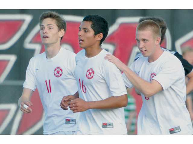 Hart soccer players, from left, Anthony Salvadori, Jeysen Rodriguez and Riley Waldeck, celebrate after scoring a goal against Valencia at Hart High on Tuesday.