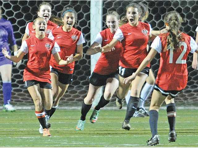 The Hart girls soccer team celebrates after scorin a goal against Valencia at Valencia High on Tuesday.