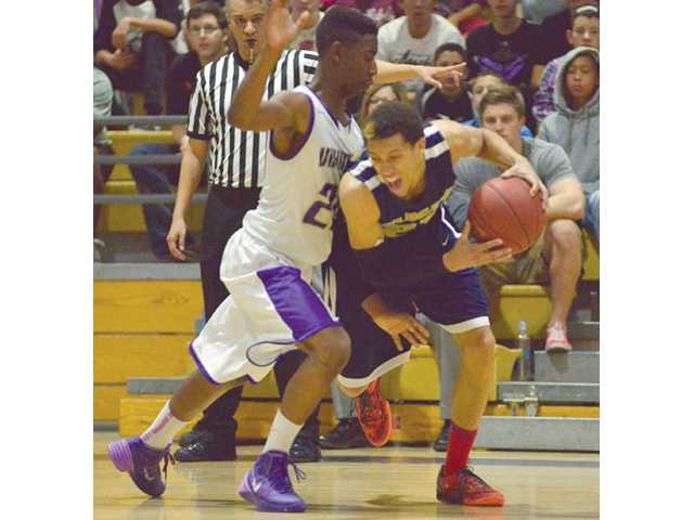 West Ranch's Christian Ware-Berry, right, tried to get by Valencia defender Malik McCowan on Thursday at Valencia High.