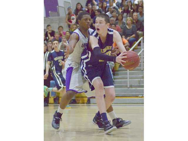 West Ranch center Ryne Williams, right, holds off a Valencia defender on Thursday at Valencia High.